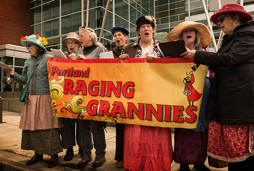 Raging Grannies sing before Pemina's hearing